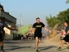 1st Lt. Benjamin Williams, executive officer for the Headquarters Support Company, Headquarters and Headquarters Battalion, 101st Airborne Division (Air Assault), runs through a color station during the Combined Joint Forces Land Component Command – Operation Inherent Resolve Color Run on Forward Operating Base Union III, Baghdad, July 2, 2016. (U.S. Army photo by Sgt. Katie Eggers/Released)