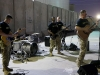 """""""Cover Down,"""" an element from the 101st Airborne Division (Air Assault) Band, perform for Soldiers outside the Eagle Fitness Center on Forward Operating Base Union III, Baghdad, July 2, 2016. The group performed popular songs for Combined Joint Forces Land Component Command – Operation Inherent Resolve service members during a day of activities celebrating the Fourth of July. (U.S. Army photo by Sgt. Katie Eggers/Released)"""