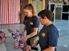Staff Sgt. Somaya Andreason and Spc. Abigail Schiltz, USO volunteers with the Combined Joint Forces Land Component Command – Operation Inherent Resolve, decorate areas of the former Erbil International Airport with U.S. flags and red, white and blue decorations prior to the start of the Independence Day celebration sponsored by the USO, Erbil Iraq, July 4, 2016. The event was held for all U.S. and Coalition service members on Erbil and included a variety of food and drink, games, and live music provided by the 101st Airborne Division (Air Assault) group, The Other Guys, and a raffle sponsored by the USO and other organizations. The event drew over three hundred members from across the Coalition and provided U.S. personnel serving in northern Iraq a touch of home during the holiday. (U.S. Army Photo by Maj. Allen Hill/Released)