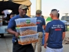 A volunteer from the Combined Joint Forces Land Component Command -- Operation Inherent Resolve, carries food that will be used in support of the Independence Day celebration sponsored by the USO and held at the former Erbil International Airport, Erbil Iraq, July 4, 2016. The event was held for all U.S. and Coalition service members in Erbil and included a variety of food and drink, games, and live music provided by the 101st Airborne Division (Air Assault) group, The Other Guys, and a raffle sponsored by the USO and other organizations. (U.S. Army Photo by Maj. Allen Hill/Released)
