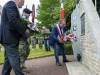 U.S. Army Staff Sgt. Daniel Desaulniers, a platoon sergeant with the 2-506th Infranty Regiment, 101st Airborne Division, and French citizens lay wreaths at the Currahee Memorial in Beuzeville au Plain, France, June 1, 2016. More than 380 service members from Europe and affiliated D-Day historical units are participating in the 72nd anniversary as part of Joint Task Force D-Day 72. (U.S. Air Force photo by Staff Sgt. Timothy Moore)