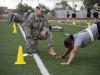 Staff Sgt. Rebecca Reeves, from the Division Signal Company, Headquarters and Headquarters Battalion, 101st Airborne Division (Air Assault), grades Sgt. Vimarie Pedro, from the 101st Combat Aviation Brigade, 101st Abn. Div., on the pushup event during the Army Physical Fitness Test, April 21, 2015, during the division's noncommissioned officer and Soldier of the year competition held here. Competitors from 2nd Brigade Combat Team and 3rd BCT would ultimately take home the titles after three days of events. (U.S. Army photo by Staff Sgt. Terrance D. Rhodes, 101st Airborne Division (Air Assault) Public Affairs)
