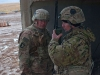 U.S. Army Sgt. 1st Class Scott Young, right, a platoon sergeant with Battery C, 1st Battalion, and 320th Field Artillery Regiment, Task Force Strike, and U.S Army Sgt. Andrew Batchelor, left, Battery C, communicate with the fire direction center at the end of a fire mission to support the Iraqi security forces during the Mosul counter offensive, Dec. 24, 2016, in northern Iraq. Battery C is supporting the ISF with indirect fires in their fight against ISIL. (U.S. Army photo by 1st Lt. Daniel Johnson)