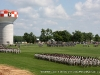 Units march along the edge of the parade grounds