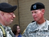 Maj. Gen. Schloesser gives a battle scarred soldier a look of respect