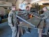 Soldiers from E Troop, 2nd Squadron, 17th Cavalry Regiment flip a steel fram into position onto a metal plate that will serve as a door in a gate on Forward Operating Base fenty, Afghanistan Dec. 11. (U.S. Army photo by Sgt. Duncan Brennan, 101st CAB public affairs)