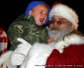 Santa with a scared young man.