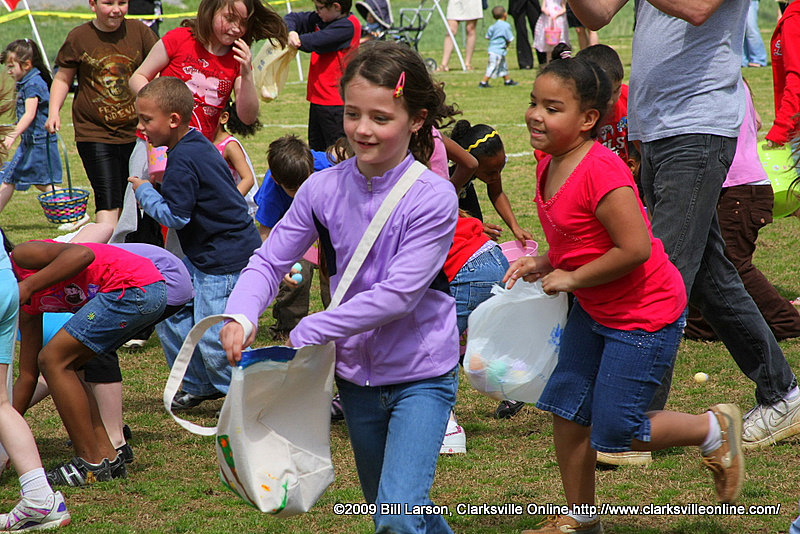 Children scoop up eggs during the Spring Eggstravaganza in 2010