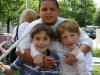 Three boys enjoy each others companionship
