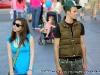 A young couple walks slowly through the vendor area