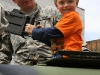 Young children get the chance to handle military weapons