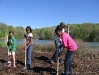 Tatyana Finks, Jennifer Murray, and Caitlin Williams of girl scout troop 2559