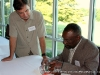 Poet/author Earl S. Braggs signs a copy of his book
