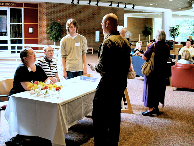 Registration attendants await conference participants check-in