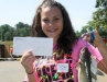Kaitlyn Gallowitz, the winner of a contest for the first girl to catch a fish. She received a $50 gift certificate.