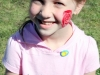 Sydney Hamilton got a rose painted on the side of her cheek.