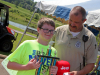 Ethan Duffie caught this year's Smallest Fish, .03 ounces, here he accepts his trophy from TWRA's Jereme Odom