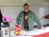 Kenny York, in the Cracker Boy Seasoning booth selling BBQ sandwiches and drinks to raise money for the Manna Cafe.
