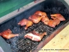 Chicken cooking on the BBQ Bunch\'s grill.