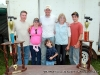 The BBQ Bunch standing behind their two trophies: (L to R) Brad Wofford, Janet Johnson, Mike Johnson, Melody Johnson, Elkie Melton and Alex Johnson.