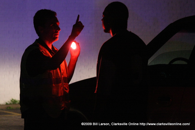 A Clarksville, TN police officer conducts a roadside sobriety test
