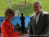 Richard V. Stevens presnets Clarksville Mayor Kim McMillan with a replica of the Pat Head Summitt statue that will be placed at the Pat Head Summitt plaza.