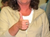 Tandem jump gift recipient gives thumbs up as she begins preparations