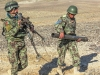 "Soldiers from the Afghan National Army, 1st Brigade, 203rd Corps, carry elements of their 82mm mortar system during a live-fire exercise that marked the conclusion of a two-week mortarmen course at the Fires Center of Excellence, Camp Parsa, Afghanistan, Jan. 3, 2013. The FCOE, a school developed and mentored by Soldiers from 3rd Battalion, 320th Field Artillery Regiment, 3rd Brigade Combat Team ""Rakkasans,"" 101st Airborne Division (Air Assault), is designed to teach sustainable practices and methods that will allow the ANA to engage the enemy effectively with improved capabilities. (U.S. Army photo by 1st Lt. Bryan Spear, 3-320th FA, Unit Public Affairs Representative)"