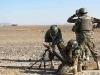 Soldiers from the Afghan National Army, 1st Brigade, 203rd Corps, begin to drop a round into their 82mm mortar system during a live-fire exercise that marked the conclusion of a two-week mortarmen course at the Fires Center of Excellence, Camp Parsa, Afghanistan, Jan. 3, 2013. (U.S. Army photo by 1st Lt. Bryan Spear, 3-320th FA, Unit Public Affairs Representative)