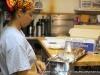 Silke\'s staffer readies a  fresh bread braid