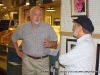 A guest chats with one of Silke\'s artists