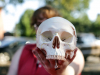 """Sam Melber of Beta Beta Beta said: """"When people come to our table, a lot of them are just curious, we have a lot of skulls and stuff out. We're trying to reach out to people in biology majors and those who aren't in biology. They can see what we're doing."""" (APSU student Benny Little)"""