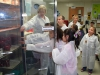 Blanchfield Army Community Hospital's supervisor of microbiology Annie Baker shows gifted students from Barsanti Elementary School how empty bacterial culture plates  are stored in a laboratory refrigerator Nov. 19, 2013 at Fort Campbell, Ky. (U.S. Army photo by Laura Boyd/RELEASED)