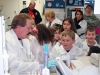 Blanchfield Army Community Hospital's blood bank technician Warren Myers shows gifted students from Barsanti Elementary School how blood is matched from donors to recipients Nov. 19, 2013 at Fort Campbell, Ky. (U.S. Army photo by Laura Boyd/RELEASED)