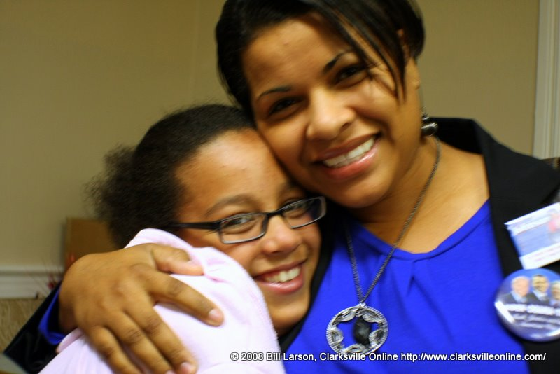 Candy Johnson, candidate, City Council Ward 5, gets hug from a young suppoorter
