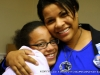 Candy Johnson, candidate for City Council Ward 5, hugs young activist
