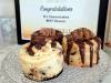 Three mini cheesecakes from B's Cheesecakes: Caramel Coconut Cookie with Samoa on top, Triple Chocolate in the back, and Tollhouse Chocolate with Peanut Caramel.