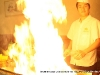 Flames rise as the Hibachi chef readies his grill