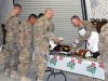 "1st. Lt. Michael Bender, Executive Officer, Company F, 3rd Battalion, 187th Infantry Regiment, 3rd Brigade Combat Team ""Rakkasans,"" 101st Airborne Division (Air Assault),  serves food to Soldiers during a Christmas celebration at Forward Operating Base Salerno, Afghanistan, Dec. 24th, 2012. (Courtesy photo)"