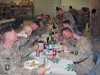 "Soldiers of the 3rd Battalion, 187th Infantry Regiment, 3rd Brigade Combat Team ""Rakkasans,"" 101st Airborne Division (Air Assault),  enjoy a Christmas Eve dinner during a celebration at Forward Operating Base Salerno, Afghanistan, Dec. 24th, 2012. (Courtesy photo)"