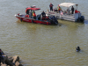 First responders search for a vehicle that went into the Cumberland River.