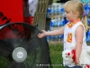 A young girl enjoys a cool misting spray from a fan