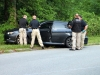 Clarksville Police investigate the scene where a man was found deceased in his 2009 Subaru Impreza. (Photo by CPD-Jim Knoll)