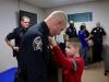Lt Daniel Lane receives his Lieutenant Badge was pinned on by his son, Caleb Lane.