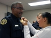 Lt Vincent Lewis receives his Lieutenant Badge was pinned on by his daughter, Tabitha Lewis