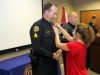 Sgt Greg Beebe being pinned by his spouse, Angela. (Photo by CPD-Jim Knoll)