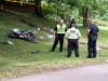 Clarksville Police Officers examine the area where a Yamaha Motorcycle crashed killing the rider.