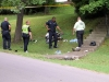 Clarksville Police Officers examine the area where a Yamaha Motorcycle crashed killing the rider. (Photo by Jim Knoll-CPD)
