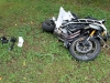Man on Yamaha Motorcycle fails to make turn, went off the road and hits a cement culvert. (Photo by Jim Knoll-CPD)