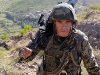 An Afghan National Army Soldier climbs a mountain in eastern Afghanistan's Kunar Province Sept. 21st. (Photo by U.S. Army Staff Sgt. Gary A. Witte, 300th Mobile Public Affairs Detachment)